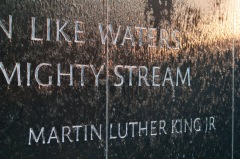 The quote from Dr. King appears on the wall about the Maya Lin Civil Rights Memorial fountain.