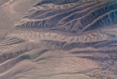 Water, wind and gravity all work to shape the landscape, here somewhere over Nevada.