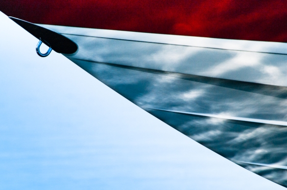 • Reflections on a Boat Hull This speedboat was lifted out of the water where the light rippled off the waves and shimmered on the hull in ways that caused me to question what is real and what is not.