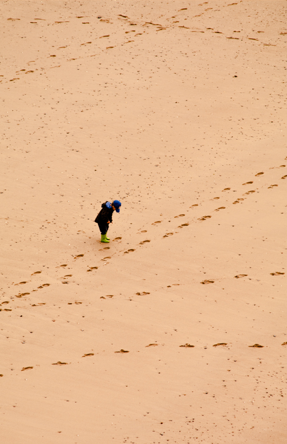 "• Wandering the beach at Tenby Tenby is a delightful, small town on the southwest coast of Wales. This young child seemed to be enjoying walking is own ""road"" while also discovering the ways others had taken."