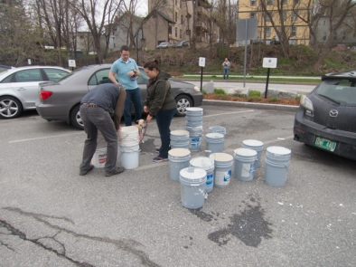 GreenUp Day volunteers preparing to fill buckets with mulch for newly planted trees