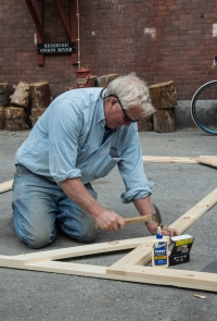 Building a frame for a friend's large triptych photograph (Photo by Elliot Burg)