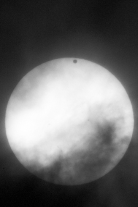 The planet Venus is a small black dot as it crosses in front of the Sun. This transit is an important reminder to me of our place in the universe.