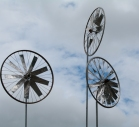 And a simple sculpture of recycled bicycle wheels plays in the wind nearby