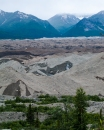 The Kennecott Glacier, shown here covered in glacial till, was high enough 100 years ago to completely hide the mountains in the background.